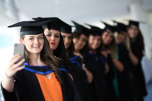 Graduating from Ulster University today with a degree in Fashion and textiles and celebrating with a selfie at the Waterfront hall in Belfast are from left, Helen Murray, Kathleen Williams, Rachel Gallagher, Amanda Nicholl, Clare Wollsey, Anna Trainor and Kirsty Waddell. Picture John Murphy Aurora Photographic Agency.