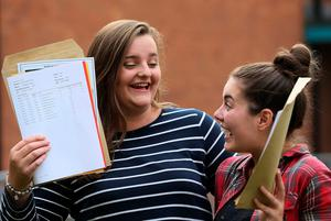 Tia Hamill (left) and Tara Burrows, from Holwood, at Sullivan Upper School, Holywood, after receiving their A level results. Brian Lawless/PA Wire