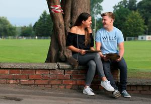 Sasha Cleere and her boyfriend Lewis Smyth at Sullivan Upper School, Holywood, after receiving their A level results. Brian Lawless/PA Wire