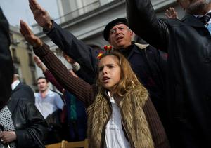 A young girl gives the fascist salute during the 39th anniversary of the death of Spanish dictator General Francisco Franco at Plaza Oriente square on November 23, 2014 in Madrid, Spain.  (Photo by Denis Doyle/Getty Images)