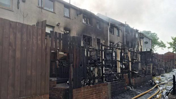 Firefighters tackle the blaze at Ballyduff Gardens. Pic: NIAS