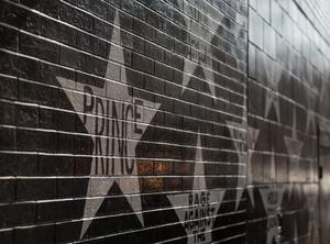 "MINNEAPOLIS, MN - APRIL 21: The ""Prince"" star on the wall outside First Avenue nightclub has become the site of a memorial for Prince on April 21, 2016 in Minneapolis, Minnesota. Prince died earlier today at his Paisley Park compound at the age of 57. (Photo by Stephen Maturen/Getty Images)"