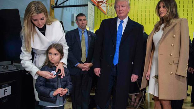Ivanka Trump (L) places a sticker on the jacket of her daughter Arabella Rose Kushner watched by Republican presidential nominee Donald Trump (2nd R) and his wife Melania after voting at a polling station in a school during the 2016 presidential elections on November 8, 2016 in New York. / AFP PHOTO / MANDEL NGANMANDEL NGAN/AFP/Getty Images