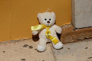 A teddy bear left as a tribute to Madeleine McCann outside the Church of Nossa Senhora da Luz in Praia Da Luz, Portugal, close to where Madeleine McCann went missing ten years ago. PRESS ASSOCIATION Photo. Picture date: Wednesday May 3, 2017. Madeleine was three when she vanished from apartment 5A on Rua Dr Agostinho da Silva in the Algarve village at about 9pm on May 3 2007. See PA story POLICE Portugal. Photo credit should read: Steve Parsons/PA Wire
