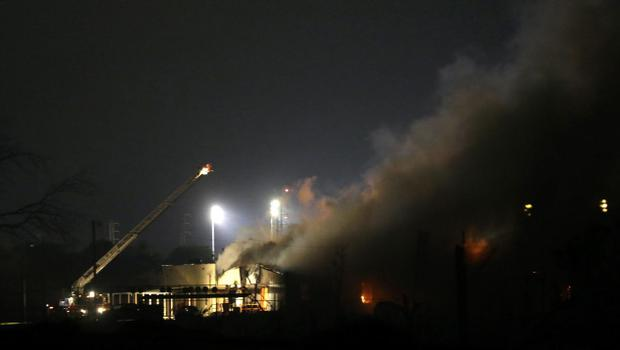 A fire smokes near a fertilizer plant that exploded earlier in West, Texas, in this photo made early Thursday morning, April 18, 2013.  (AP Photo/LM Otero)