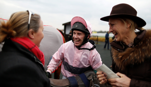 Double century: Richard Johnson celebrates with connections after riding his 200th winner of the season, Cheat The Cheater, at Warwick yesterday