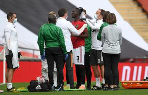 Manchester United's Eric Bailly received lengthy treatment for a head injury (Andy Rain/NMC Pool/PA)