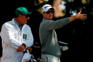 AUGUSTA, GEORGIA - APRIL 07:  Justin Rose of England talks to caddie Mark Fulcher on the second tee during the first round of the 2016 Masters Tournament at Augusta National Golf Club on April 7, 2016 in Augusta, Georgia.  (Photo by Kevin C. Cox/Getty Images)