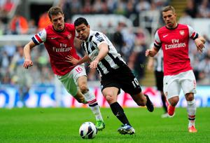 NEWCASTLE UPON TYNE, ENGLAND - MAY 19:  Hatem Ben Arfa (C) of Newcastle in action against Aaron Ramsey (L) of Arsenal during the Barclays Premier League match between Newcastle United and Arsenal at St James' Park on May 19, 2013 in Newcastle upon Tyne, England.  (Photo by Stu Forster/Getty Images)