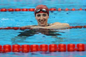 Paralympic gold medallist Bethany Firth has been awarded an MBE for services to swimming.