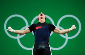 RIO DE JANEIRO, BRAZIL - AUGUST 09:  Serghei Cechir of Moldova celebrates during the Men's 69 kg Group B Weightlifting contest on Day 4 of the Rio 2016 Olympic Games at the Riocentro - Pavilion 2 on August 9, 2016 in Rio de Janeiro, Brazil.  (Photo by Julian Finney/Getty Images)