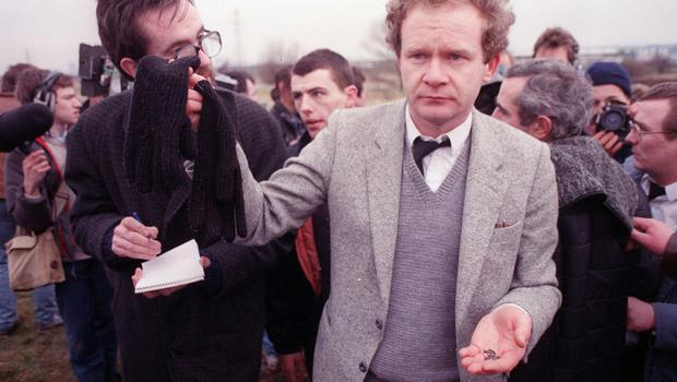 Funeral in West Belfast of the Gibraltar bombers; Mairead Farrell, Sean Savage and Danny McCann. Martin McGuinness with Michael Stone's gloves and bullets after the loyalist attacked the funeral 22/6/88