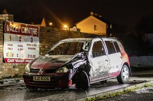 A burnt car on the Stewartstown road in west Belfast after police arrest three males aged 15, 16 and 17 on April 22nd 2020 (Photo by Kevin Scott for Belfast Telegraph)