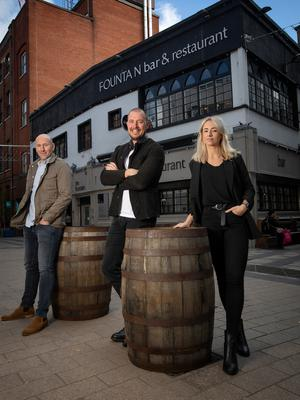 Andrew Maxwell (left), Jim Conlon and Zoe Watson of the Clover Group