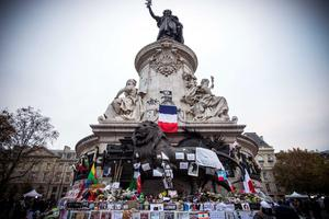 This picture shows a general view of tributes laid to victims of the Paris attacks at the foot of the Monument a La Republique in Paris on November 16, 2015.    Islamic State jihadists claimed a series of coordinated attacks by gunmen and suicide bombers in Paris on November 13 that killed at least 129 people in scenes of carnage at a concert hall, restaurants and the national stadium. AFP PHOTO /  LIONEL BONAVENTURELIONEL BONAVENTURE/AFP/Getty Images