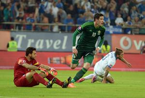 Striking success: Kyle Lafferty seals historic 2-0 win over Greece in Athens