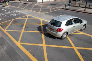 Local authorities in London and Cardiff raked in nearly £60m in just 12 months from drivers caught breaking road rules such as blocking yellow box junctions (Dominic Lipinski/PA)