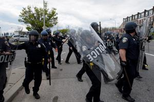 Baltimore police officers clash with protesters in the streets near Mondawmin Mall April 27, 2015 in Baltimore, Maryland. Violent street clashes erupted in Baltimore on Monday after friends and family gathered for the funeral of Freddie Gray, a 25-year-old black man whose death in custody triggered a fresh wave of protests over US police tactics. Police said at least seven officers were injured -- one of them was unresponsive -- as youths hurled bricks and bottles and destroyed at least one police vehicle in the vicinity of the shopping mall not far from the church where the funeral took place.  AFP PHOTO/BRENDAN SMIALOWSKIBRENDAN SMIALOWSKI/AFP/Getty Images