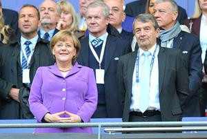Chancellor of Germany Angela Merkel (left) watches from the stands alongside President of the German Footall Association Wolfgang Niersbach (right) during the UEFA Champions League Final at Wembley Stadium, London. PRESS ASSOCIATION Photo. Picture date: Saturday May 25, 2013.