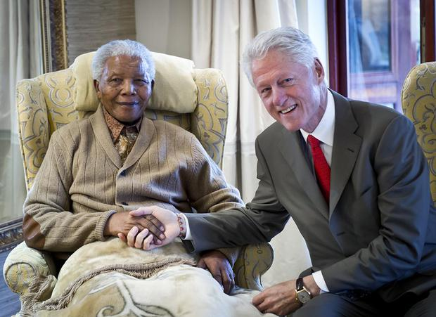 QUNU, SOUTH AFRICA - JULY 17:  In this handout provided by the Clinton Foundation, former U.S. President Bill Clinton (R) poses with former South African President Nelson Mandela on the eve of his 94th birthday at his residence July 17, 2012 in Qunu, South Africa.  Along with his daughter Chelsea, Clinton met with Mandela for 90 minutes.  (Photo by Barbara Kinney/Clinton Foundation via Getty Images)