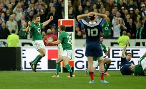 Ireland's Brian O'Driscoll (left) celebrates with team mate Fergus McFadden on the final whistle after the Six Nations match at the Stade de France, Paris, France.