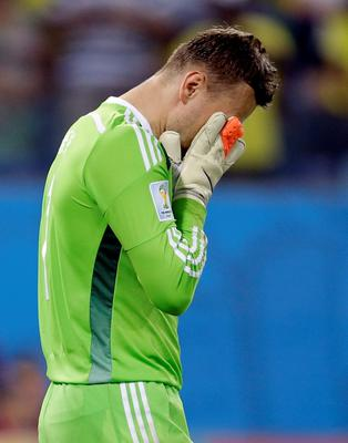 Russia's goalkeeper Igor Akinfeev reacts after letting in the opening goal during the group H World Cup soccer match between Russia and South Korea at the Arena Pantanal in Cuiaba, Brazil, Tuesday, June 17, 2014. (AP Photo/Kirsty Wigglesworth)