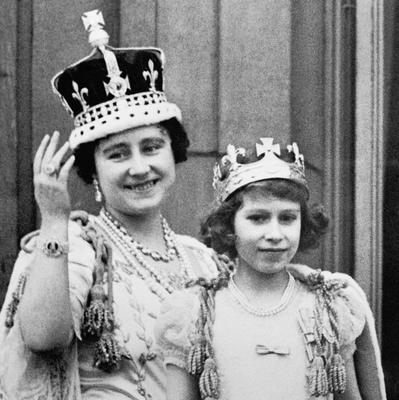 File photo dated 12/05/1937 of Queen Elizabeth (the Queen Mother) with her eldest daughter Princess Elizabeth (now Queen Elizabeth II) on the balcony of Buckingham Palace, after the coronation of King George VI as the Queen turns 90 on the April 21st.