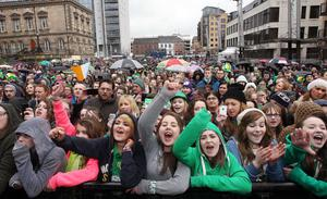 Northern Ireland- 17th March 2013 Mandatory Credit - Photo-Jonathan Porter/Presseye.  Belfast Annual St Patrick's Carnival Parade in the City Centre.  The carnival started with a parade from the CIty Hall and was  followed by a concert in Custom House Square with a number of acts including The Voice's David Julien and X Factor's Amelia Lily.  Fans pictured during the concert.