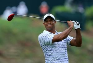 LOUISVILLE, KY - AUGUST 08:  Tiger Woods of the United States hits his tee shot on the 15th hole during the second round of the 96th PGA Championship at Valhalla Golf Club on August 8, 2014 in Louisville, Kentucky.  (Photo by David Cannon/Getty Images)