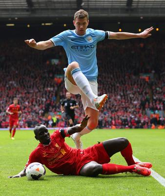 LIVERPOOL, ENGLAND - APRIL 13:  Mamadou Sakho of Liverpool challenges Edin Dzeko of Manchester City during the Barclays Premier League match between Liverpool and Manchester City at Anfield on April 13, 2014 in Liverpool, England.  (Photo by Alex Livesey/Getty Images)