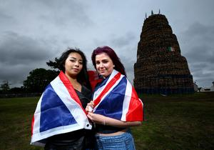 Haidee de Sesto and Linda Ritele pictured as they wait for the Ballymacash bonfire in Lisburn to be lit for the 11th of July celebration. William Cherry/Presseye.