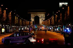 Police officers block the access to the Champs Elysees in Paris after a shooting on April 20, 2017. AFP/Getty Images