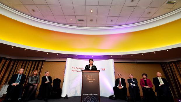 BELFAST, NORTHERN IRELAND - DECEMBER 17:  The new DUP leader Arlene Foster (C) addresses the media and party colleagues at the Park Avenue hotel after the Democratic Unionist Party electoral college meeting on December 17, 2015 in Belfast, Northern Ireland. Arlene Foster succeeds Peter Robinson and becomes the first female leader of the Democratic Unionist Party. No other nominations were put forward for the role of leader. Mrs Foster will also be appointed as the new Northern Ireland first minister in the coming weeks. The former Ulster Unionist Party member has enjoyed a rapid rise through the ranks of the DUP following her defection in 2004, twice standing in as temporary first minister for Peter Robinson in times of personal and political crisis. The DUP remain the largest political party within the provinces' Executive government.  (Photo by Charles McQuillan/Getty Images)
