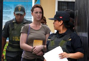 Michaella McCollum Connolly, handcuffed, arrives for a court hearing, in Lima, Peru (AP Photo/Karel Navarro)