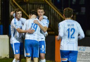 Double goal-scorer Curtis Allen is congratulated by team-mates at Taylor's Avenue.