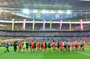 Players from both teams shake hands before kick-off during the UEFA Champions League Final at Wembley Stadium, London. PRESS ASSOCIATION Photo. Picture date: Saturday May 25, 2013.