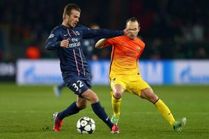 PARIS, FRANCE - APRIL 02:  David Beckham of Paris Saint-Germain is challenged by Andres Iniesta of Barcelona during the UEFA Champions League Quarter Final match between Paris Saint-Germain and Barcelona FCB at Parc des Princes on April 2, 2013 in Paris, France.  (Photo by Clive Rose/Getty Images)