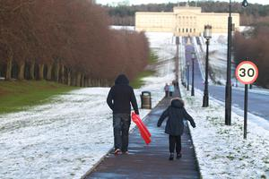 10/12/17 PACEMAKER PRESS  People make the best of the snow in the grounds of Stormont.  PICTURE MATT BOHILL PACEMAKER PRESS