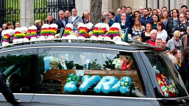 Mourners react as the coffin of journalist Lyra McKee, who was killed by a dissident republican paramilitary in Northern Ireland on April 18, is placed into a hearse following her funeral at St Anne's Cathedral in Belfast on April 24, 2019. - Lyra McKee, 29, who chronicled the troubled history of Northern Ireland, was shot in the head on April 18, 2019, as rioters clashed with police in Londonderry, the second city of the British province. (Photo by Paul Faith / AFP)PAUL FAITH/AFP/Getty Images