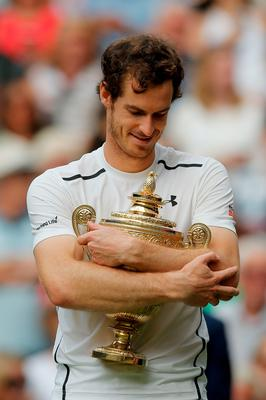 TOPSHOT - Britain's Andy Murray poses with the winner's trophy after his men's singles final victory over Canada's Milos Raonic on the last day of the 2016 Wimbledon Championships at The All England Lawn Tennis Club in Wimbledon, southwest London, on July 10, 2016. / AFP PHOTO / POOL AND AFP PHOTO / Andrew COULDRIDGE / RESTRICTED TO EDITORIAL USEANDREW COULDRIDGE/AFP/Getty Images