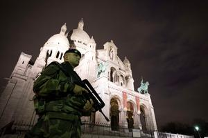 TOPSHOTS  A French soldier enforcing the Vigipirate plan, France's national security alert system, patrols in front of the Sacre Coeur Basilica on November 16, 2015 in Paris, three days after a series of deadly coordinated attacks claimed by Islamic State jihadists, which killed at least 129 people and left more than 350 injured on November 13. AFP PHOTO/JOEL SAGETJOEL SAGET/AFP/Getty Images