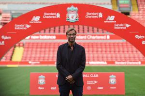 "Liverpool's new German manager Jurgen Klopp poses on the pitch after a press conference to announce his new appointment at Anfield in Liverpool, northwest England, on October 9, 2015. Klopp described his job as ""the biggest challenge"" in world football on October 9 following his appointment as the successor to Brendan Rodgers. Former Borussia Dortmund head coach Klopp, 48, was appointed on October 8 on a three-year contract following the dismissal of Rodgers, who was sacked October 4 after three and a half years at the club.  AFP PHOTO / PAUL ELLIS    RESTRICTED TO EDITORIAL USE. No use with unauthorized audio, video, data, fixture lists, club/league logos or 'live' services. Online in-match use limited to 75 images, no video emulation. No use in betting, games or single club/league/player publications.PAUL ELLIS/AFP/Getty Images"