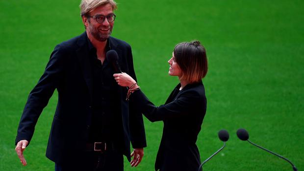 Liverpool's German manager Jurgen Klopp (L) speaks during the ceremonial opening of Liverpool Football Club's new main stand, at Anfield stadium in Liverpool, north-west England, on September 9, 2016.   / AFP PHOTO / PAUL ELLISPAUL ELLIS/AFP/Getty Images