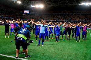Iceland's Aron Gunnarsson (centre) leads the Iceland celebrations on the pitch after the Round of 16 match at Stade de Nice, Nice, France. PRESS ASSOCIATION Photo. Picture date: Monday June 27, 2016. See PA story SOCCER England. Photo credit should read: Nick Potts/PA Wire. RESTRICTIONS: Use subject to restrictions. Editorial use only. Book and magazine sales permitted providing not solely devoted to any one team/player/match. No commercial use. Call +44 (0)1158 447447 for further information.