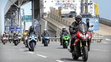 A convoy of hundreds of bikers ride off Stena Superfast VIII at the Belfast Port to make their way to the International North West 200