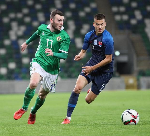 Pacemaker Belfast 16-10-18 Northern Ireland v Slovakia - UEFA Euro U21 Qualifier Northern Ireland's Jamie McDonagh and Slovakia's Laszlo Benes during this evenings game at the National Stadium, Belfast.  Photo by David Maginnis/Pacemaker Press