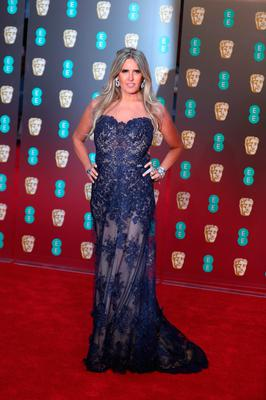 Italian producer Tiziana Rocca poses on the red carpet upon arrival at the BAFTA British Academy Film Awards at the Royal Albert Hall in London on February 18, 2018. / AFP PHOTO / Daniel LEAL-OLIVASDANIEL LEAL-OLIVAS/AFP/Getty Images