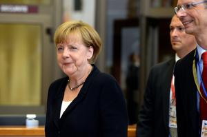 German Federal Chancellor Angela Merkel leaves at the end of a Special EU Summit on the Greek crisis at the EU Council building in Brussels, July 07, 2015. European leaders gave debt-stricken Greece a final deadline of July 12 to reach a new bailout deal and avoid crashing out of the euro, after Greek voters rejected international creditors' plans in a weekend referendum. AFP PHOTO/THIERRY CHARLIERTHIERRY CHARLIER/AFP/Getty Images