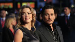 Amber Heard and Johnny Depp attending the premiere of Black Mass during the 59th BFI London Film Festival at the Odeon Leicester Square, London.