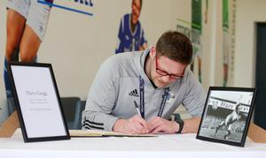Dungannon Swifts manager Kris Lindsay signs the book. Picture by Jonathan Porter/PressEye